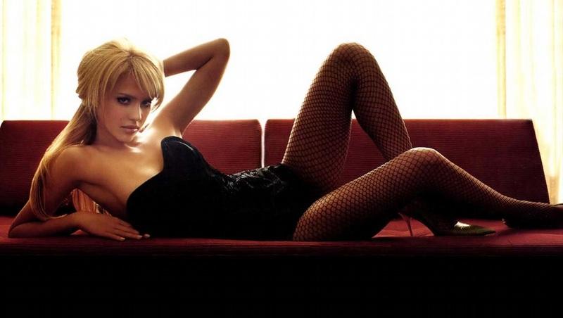 Jessica Alba in black corset fishnet stockings.